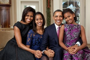 First Lady Michelle Obama with President Barack Obama and their daughters, Malia and Sasha, in the Oval Office. (Official White House Photo by Pete Souza)