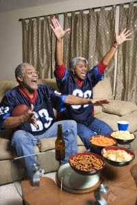 Football parties are great ways to gather family and friends. (Ron Chapple Studios/Thinkstock by Getty Images)
