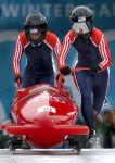 Vonetta Flowers, left, the first black athlete to win gold in the Winter Olympics, heads down the track with bobsled partner Jill Bakken in Park City, Utah, in 2002. (Public Domain)