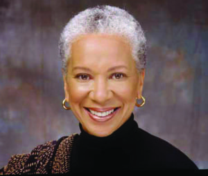 Angela Blackwell, founder and CEO of PolicyLink, encourages women to fight at the grassroots level for better childcare, public transportation and safer streets.