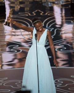 "Lupita Nyong'o accepts the Oscar® for performance by an actress in a supporting role for her role in ""12 Years a Slave."" (Aaron Poole / ©A.M.P.A.S.)"