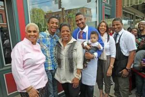 Oprah Winfrey pays a surprise visit to Robbie Montgomery and her family at Sweetie Pie's in St. Louis. (George Burns/Harpo Inc.)