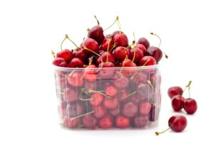 Red cherries in plastic container