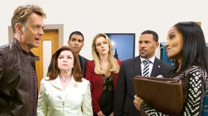 """Shari Headley's character, District Attorney Jennifer Sallison, confronts Judge James Cryer (John Schneider) on """"The Haves and the Have Nots."""" (Photo credit: Oprah Winfrey Network/OWN)"""