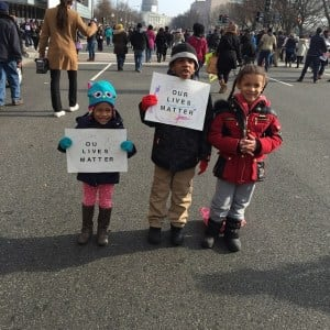"Saa Nassel, 3, Jayelin Robinson , 6, and Liliana Wheeler, 5, with signs saying ""Our Lives Matter"" at the Justice for All March. (Photo courtesy of Kenrya Rankin Nassel)"