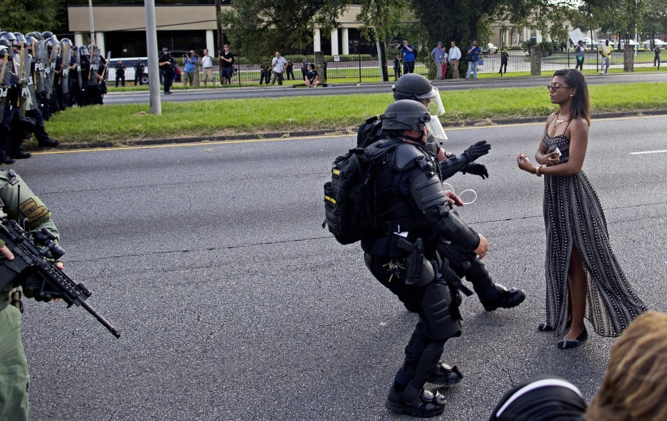 This photo of Ieshia Evans, a 28-year-old nurse who traveled from New York to a protest in Baton Rouge, La., has become a symbol of the #BlackLivesMatter movement. (Photo: Jonathan Bachman/Reuters)
